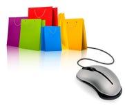 Хозяйственные сумки и мышь компьютера. Принципиальная схема e-sho Стоковые Изображения