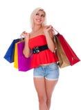 Хозяйственные сумки удерживания женщины против стоковые фотографии rf