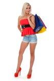 Хозяйственные сумки удерживания женщины против Стоковое Изображение