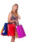 Хозяйственные сумки удерживания женщины против стоковое изображение rf