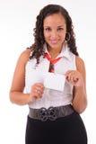 Хозяюшка показывая ее значок Стоковая Фотография