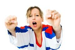 Хоккейный поклонник женщины в jersey в национальном цвете приветственного восклицания России, празднуя цель стоковые фото