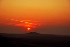 холмы dobrogea над заходом солнца Стоковое Изображение RF