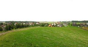 Холм и дома в лете, Литва стоковое фото rf