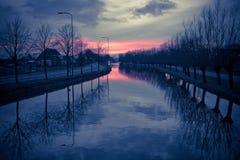 холодный заход солнца Стоковые Изображения