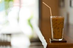 Холодный кофе на деревянном столе Стоковые Фотографии RF