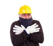 Холод работника терпя при пересеченные рукоятки Стоковые Изображения