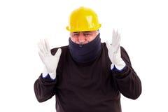 Холод работника терпя с рукоятками вверх Стоковое фото RF