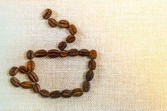 Холст дерюги мешковины и предпосылка фото кофейных зерен экземпляр Стоковые Фотографии RF