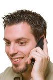 хороший слушая телефон весточки человека к Стоковые Изображения