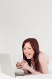 Хороший смотря red-haired женский ослаблять стоковое фото rf