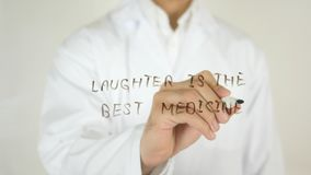 Хохот самое лучшее лекарство, написанное на стекле Стоковые Изображения RF
