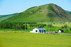 Холмы и дом Стоковые Фотографии RF
