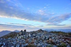 Холмы на восходе солнца Стоковые Изображения