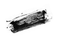 Ход (образец) черного mascara, изолированный на белом макросе стоковое изображение
