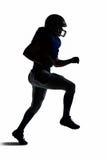 Ход футболиста силуэта американский Стоковое Изображение RF