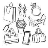 Ходя по магазинам комплект и собрание товаров широкого потребления Стоковые Изображения RF