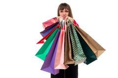 Ходя по магазинам приобретения, много красочных бумажных сумок, пакеты в женщине Стоковые Фото
