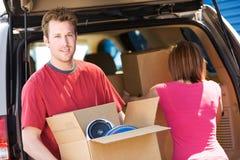 Хранение: Коробка нося человека Стоковая Фотография