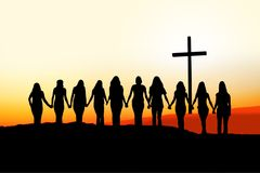 Христианский силуэт приятельства женщин Стоковая Фотография
