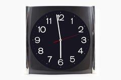 Хронометрируйте черно-серое нержавеющее на стене и таблице изолированных на whi Стоковая Фотография