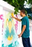 Художник надписи на стенах на поставке улицы Стоковая Фотография RF