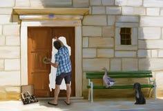 Художник стоя в его собственной картине маслом стоковые изображения rf