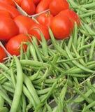 хуторянин фасолей выходят томаты вышед на рынок на рынок Стоковое Изображение