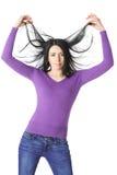 Худенькая женщина поднимает изоляцию рук волос Стоковая Фотография RF