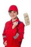 Художник женщины в красных изолированных coveralls стоковое фото rf
