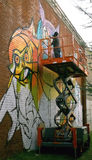 Художник CAM Бруклин Нью-Йорк США настенной росписи стоковое изображение rf
