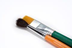2 художнических кисти на белой предпосылке Стоковые Изображения RF
