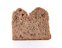 Хлеб всей пшеницы изолированный на белой предпосылке стоковые фотографии rf