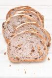 Хлеб грецкого ореха на белой деревянной предпосылке Стоковое Изображение
