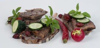 Хлеб и мясо на предпосылке Стоковые Изображения RF