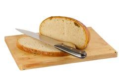 Хлеб на деревянной доске на белизне Стоковые Изображения