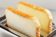 хлеб отрезает тостер Стоковое Изображение