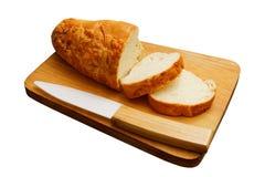 Хлеб Lucianas и керамический нож изолированные на белизне Стоковые Фото
