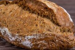 Хлеб Rye на деревянной предпосылке Стоковая Фотография RF