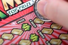Царапать билет лотереи стоковое фото