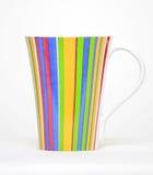 Цветастая кофейная чашка изолированная на белой предпосылке Стоковое Изображение