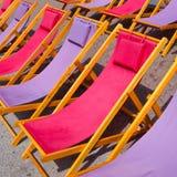 Цветастая предпосылка стулов пляжа Стоковые Фото
