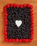 Цветастая рамка границы сделанная ягод Стоковая Фотография