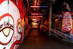 Цветастые граффити на стене Стоковая Фотография