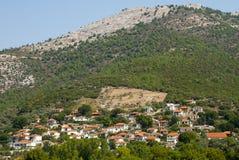 цветастые греческие дома горного склона Стоковое фото RF