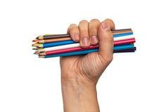 цветастые карандаши руки стоковая фотография