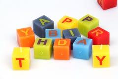 Цветастые кубики с письмами стоковое изображение
