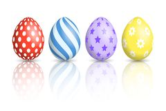Цветастые пасхальные яйца на белой предпосылке Стоковое Изображение