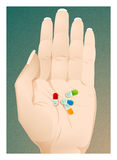 цветастые пилюльки руки Стоковая Фотография RF