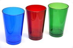Цветастые пластичные чашки Стоковое Фото